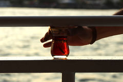 Drinking Turkish tea from bosphorus at istanbul Royalty Free Stock Images