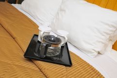 Drinking utensils on bed Stock Photography
