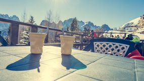 Drinking warm and tasty coffee at ski resort. Royalty Free Stock Photo