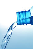 Drinking Water. Pouring water from pvc bottle Royalty Free Stock Images