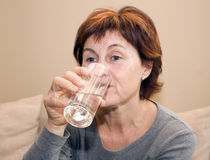 Drinking water. My mother at a caffe, drinking water Royalty Free Stock Photos