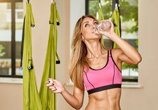 Drinking water after Antigravity yoga Royalty Free Stock Images
