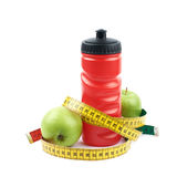Drinking water bottle and apples Stock Photo
