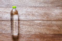 Drinking water bottle on vintage wooden background stock photography