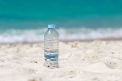 Water in bottle on beach Stock Photography