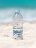 Water in bottle on beach Royalty Free Stock Photos