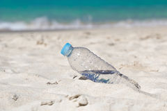 Water in bottle on beach Royalty Free Stock Photography