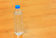 Drinking water bottle on wood background. Stock Image