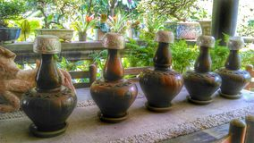 Drinking water earth jars and small water bowls Royalty Free Stock Photo