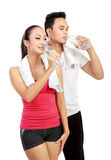 Drinking water after exercising Stock Photos