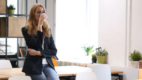 Drinking Water in Glass, Businesswoman Sitting on Desk. High quality stock images