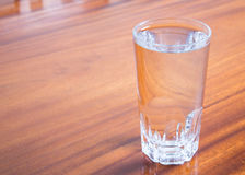 Drinking water. A glass of drinking water on tableware made ​​of wood Stock Photography
