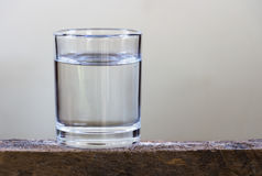 Drinking water in glass on a wooden floor. Drink glass water wooden floor royalty free stock photography