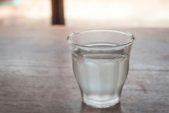 Drinking water in a glass on wooden table Stock Photos
