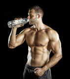 Drinking water in gym Royalty Free Stock Photography