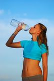 Drinking water after jogging Royalty Free Stock Image
