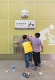 Drinking water at Kuala Lumpur airport Royalty Free Stock Photo