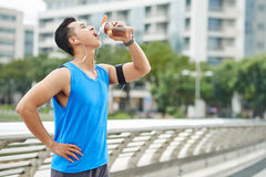 Drinking water after marathon Royalty Free Stock Images