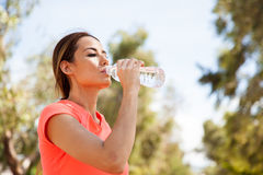 Drinking water outdoors Stock Images