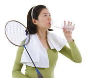 Drinking water after playing badminton Royalty Free Stock Image