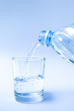 Drinking water pour into a glass. Royalty Free Stock Photo