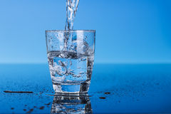 Drinking water. Is poured into a glass Royalty Free Stock Photos