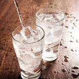 Drinking water is poured into a glass Stock Photography