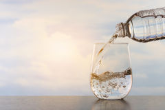 Drinking water. Poured into the glass Royalty Free Stock Images