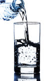 Drinking water pouring in glass Royalty Free Stock Photos