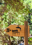 Drinking water refill and rest spot signs on a wooden board Stock Images