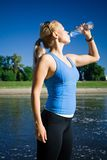 Drinking water after running Royalty Free Stock Image