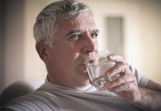 Drinking water. Senior man drinking water. Close up stock images
