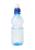 Drinking water in a small bottle. Drinking water in a small (0,3 liter) bottle. An isolated object. A white background Royalty Free Stock Photo