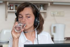 Drinking water at work Stock Photography