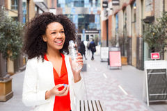 Drinking water. A young woman drinking water Royalty Free Stock Image