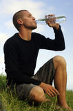 Drinking water1. Young man's drinking a bottle of water Royalty Free Stock Photo