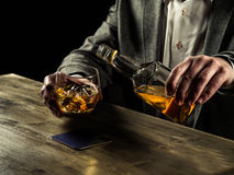 Drinking whiskey at night Stock Photo
