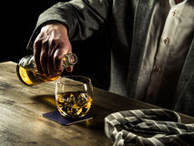 Drinking whiskey at night Royalty Free Stock Image