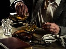 Drinking whiskey at night Royalty Free Stock Photos