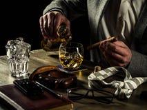 Drinking whiskey at night Stock Photos