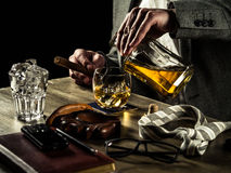 Drinking whiskey at night Royalty Free Stock Photo