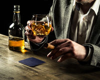 Drinking whiskey at night Royalty Free Stock Photos