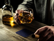 Drinking whiskey at night Royalty Free Stock Images