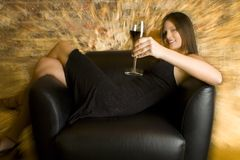 Drinking Wine. A beautiful young woman drinking glass of wine royalty free stock photo