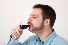 Drinking Wine. Young man drinking red wine Royalty Free Stock Photography