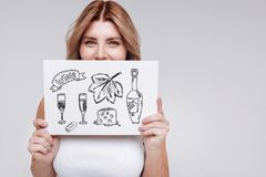 Cute young woman smiling and thinking about drinking wine stock images