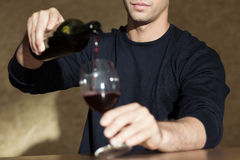 Drinking wine alone at home Royalty Free Stock Images