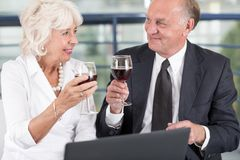 Drinking wine during meeting Royalty Free Stock Images