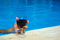 Drinking wine in the pool Stock Photography