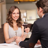 Drinking wine and smiling Royalty Free Stock Photo